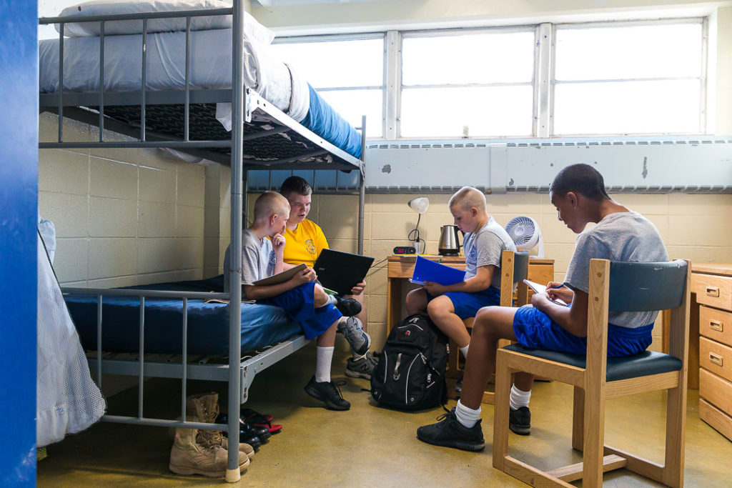 cadets studying in a dorm room