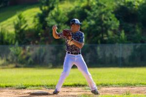 southern prep baseball player throwing ball