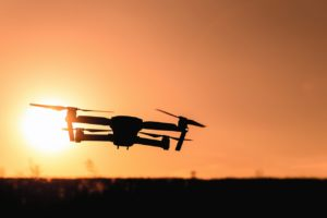 camera drone at sunset