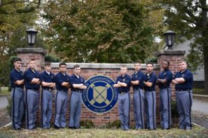 cadets standing at southern prep brick gate