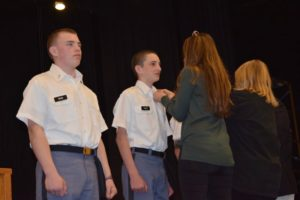 two cadets getting their pins