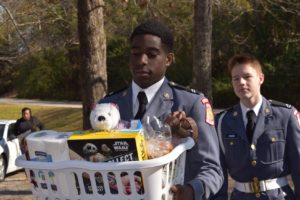 ranger delivering donations in a laundry basket