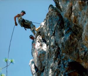 cadet repelling down rocks
