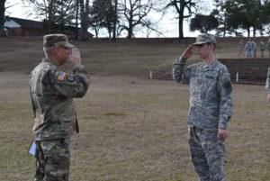 two saluting men