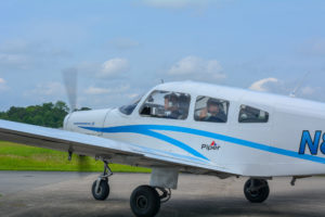 cadets flying piper airplane