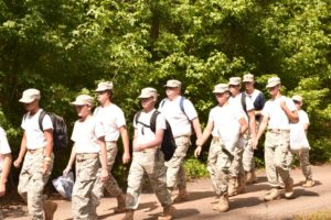 marching cadets in the woods
