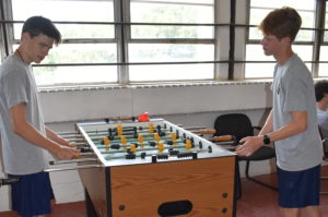 two cadets playing foosball