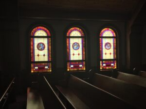 chapel stained glassed windows at sunset