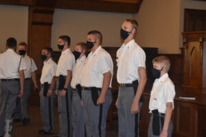 masked cadets in deans list ceremony