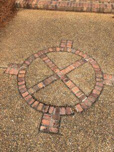 circle of bricks on sidewalk