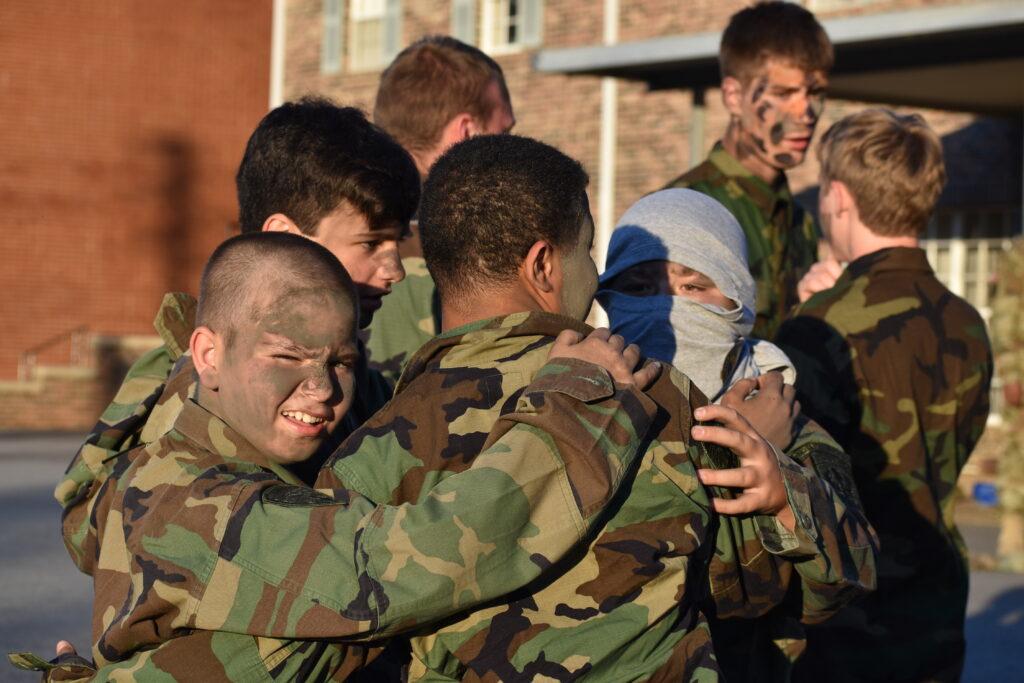 paintball boys team in a huddle